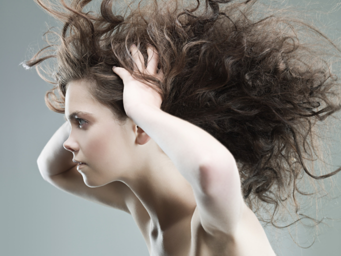 Young woman with with wild hair